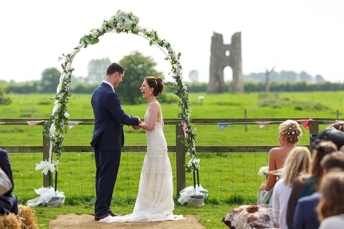 an outside wedding ceremony at godwick hall