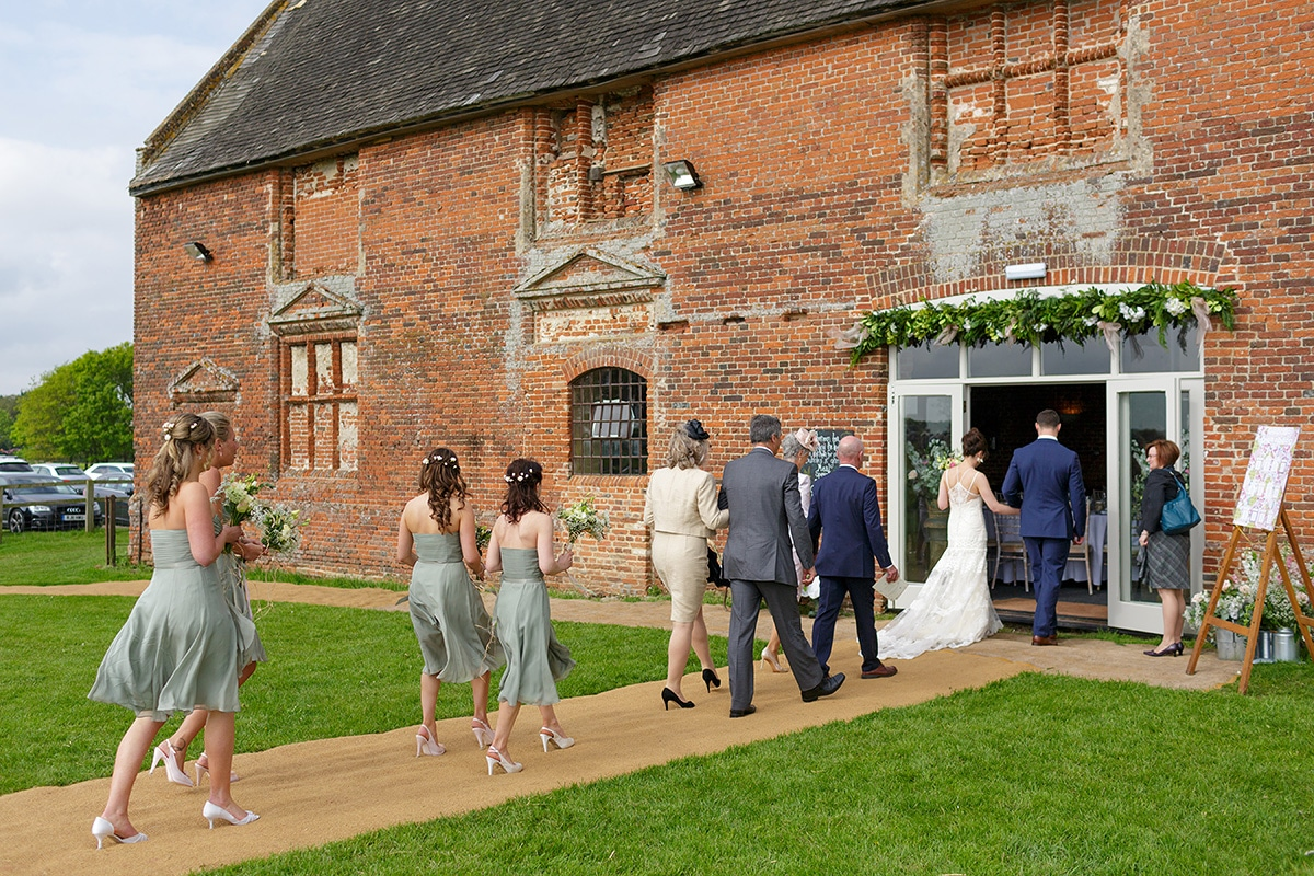 the wedding party enter godwick barn for the legal ceremony