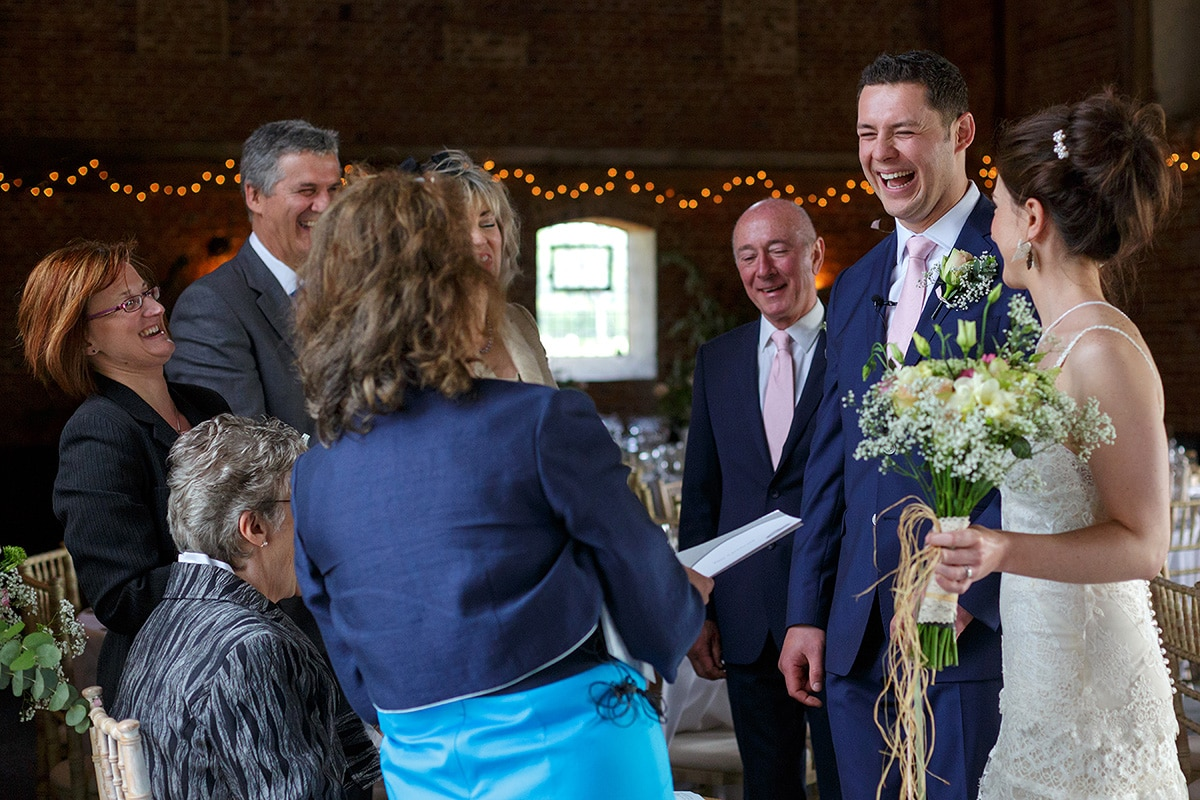the groom laughing with the registrar
