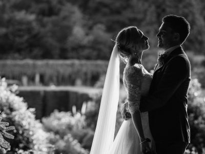 a backlit wedding potrait in the grounds of voewood in north norfolk