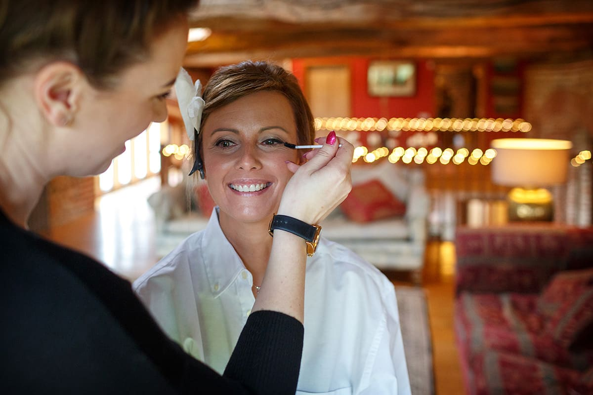 the bride having her makeup applied