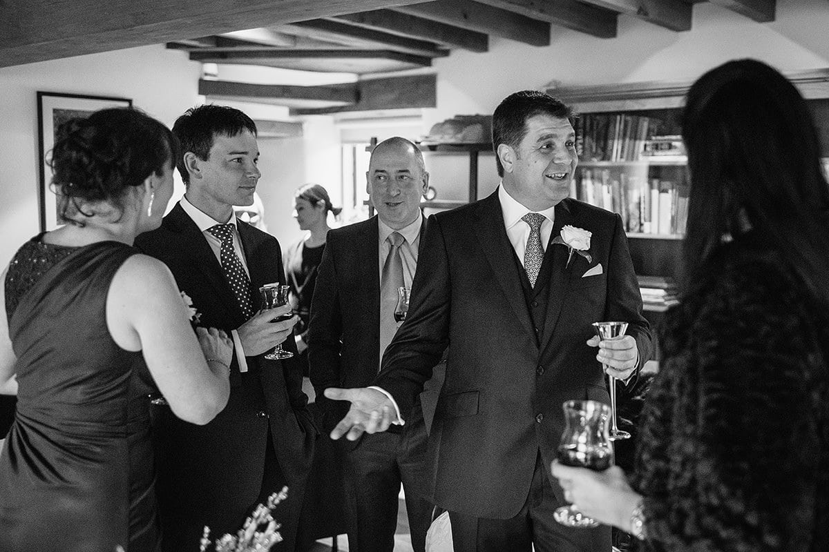 the groom greets guests before the wedding ceremony
