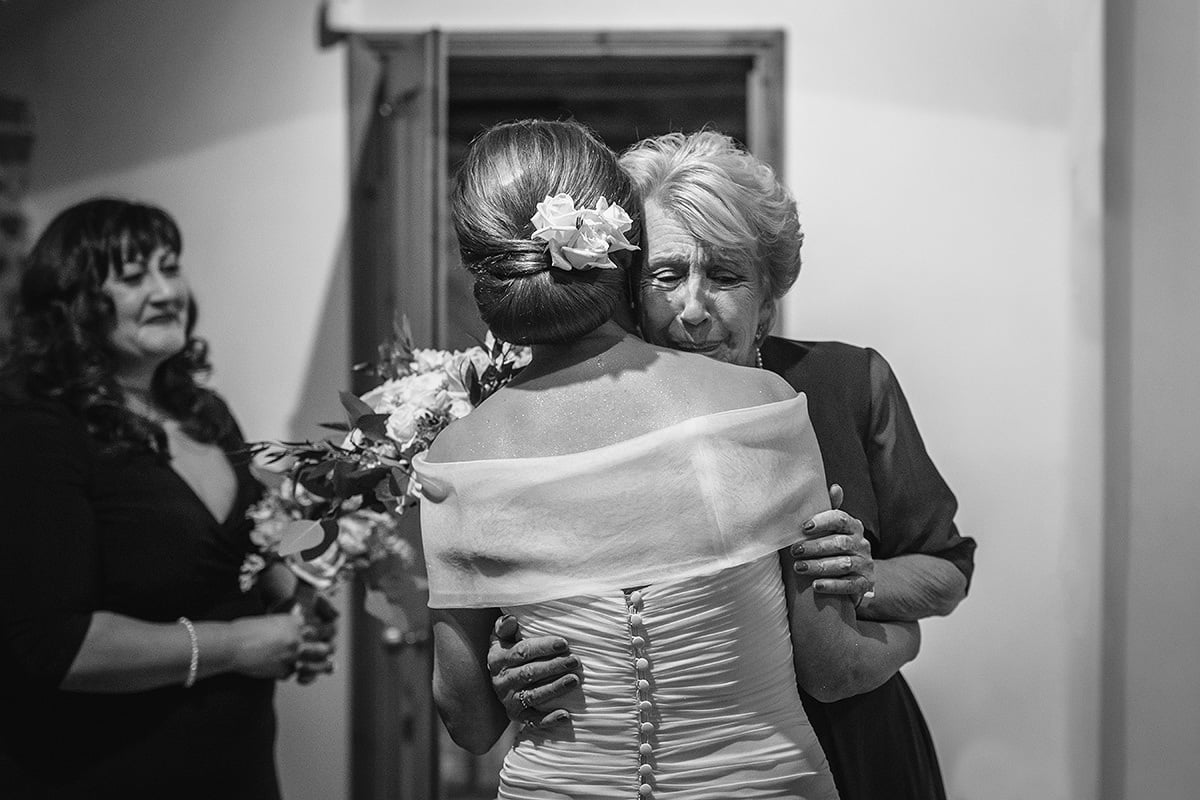 the bride and her mother embrace
