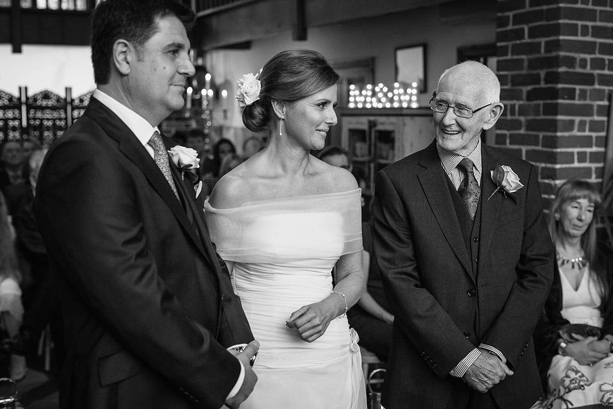 the father of the bride smiles