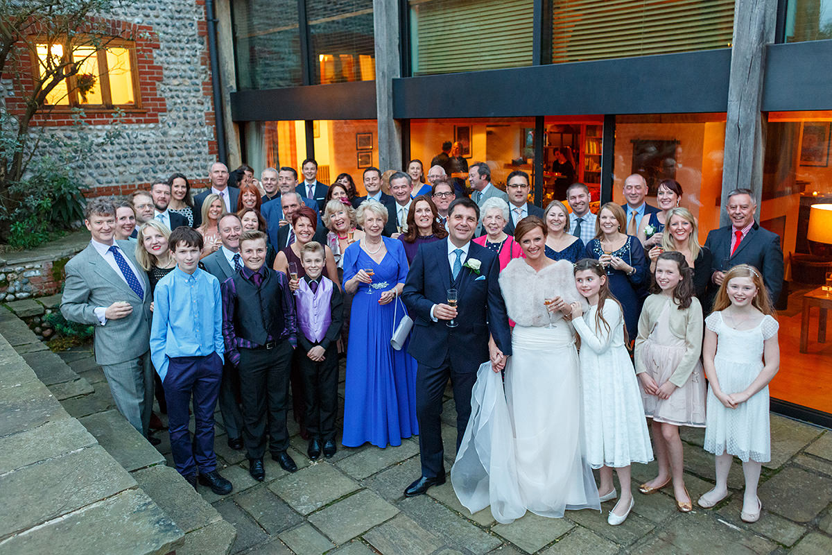 a group shot of the whole wedding at chaucer barn