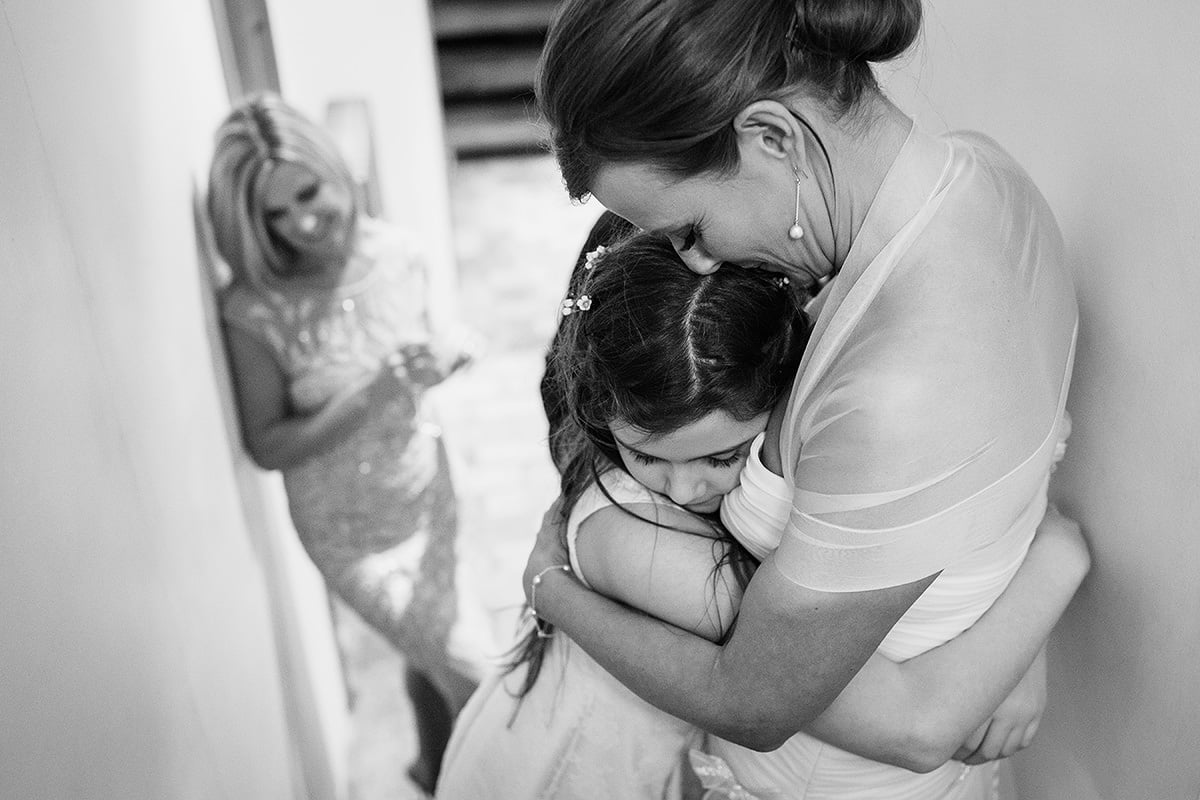the bride hugs her daughter