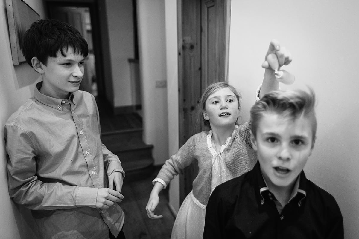 children play upstairs at the wedding