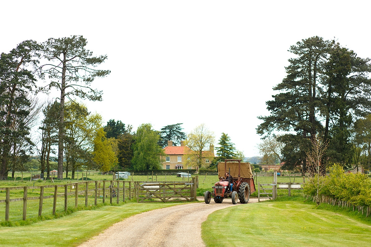 the bride rides to godwick barn on a tractor