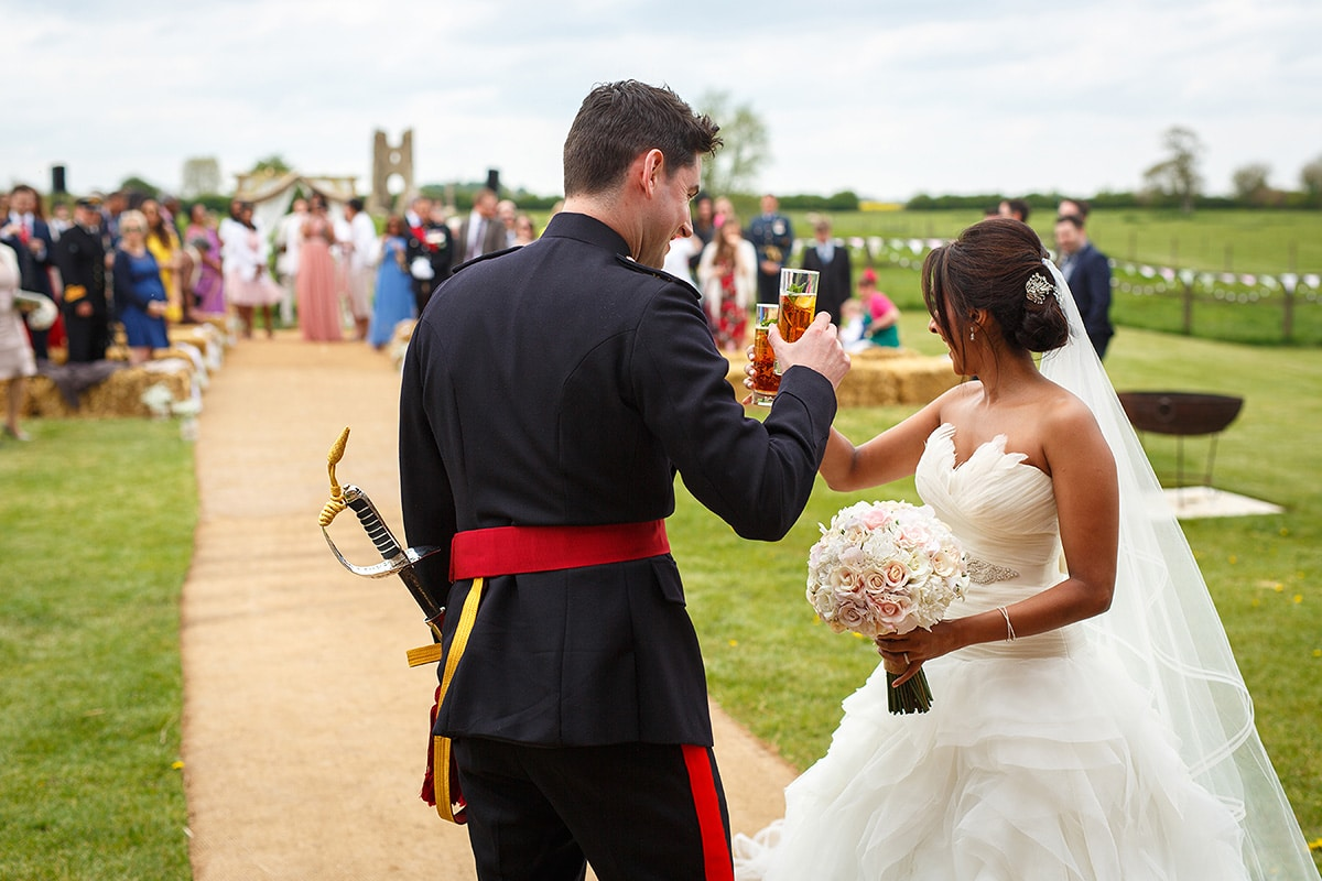 bride and groom toast their guests