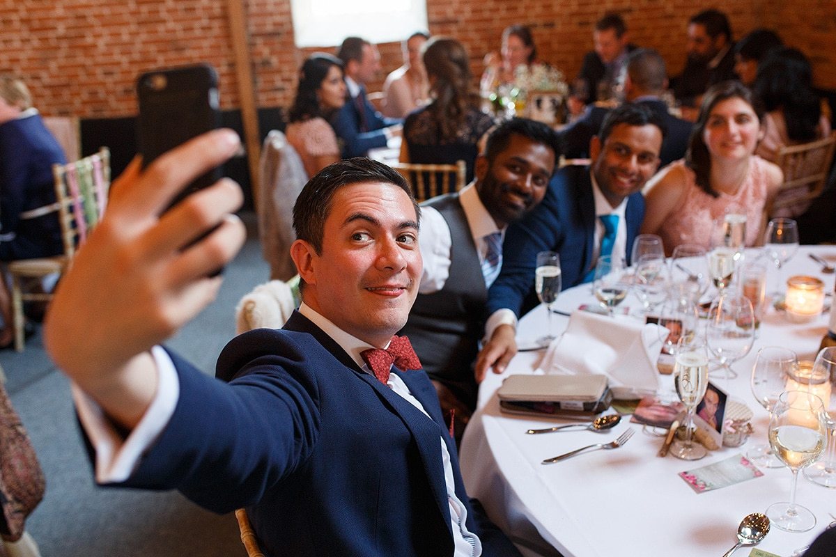 wedding guests taking a selfie at godwick barn
