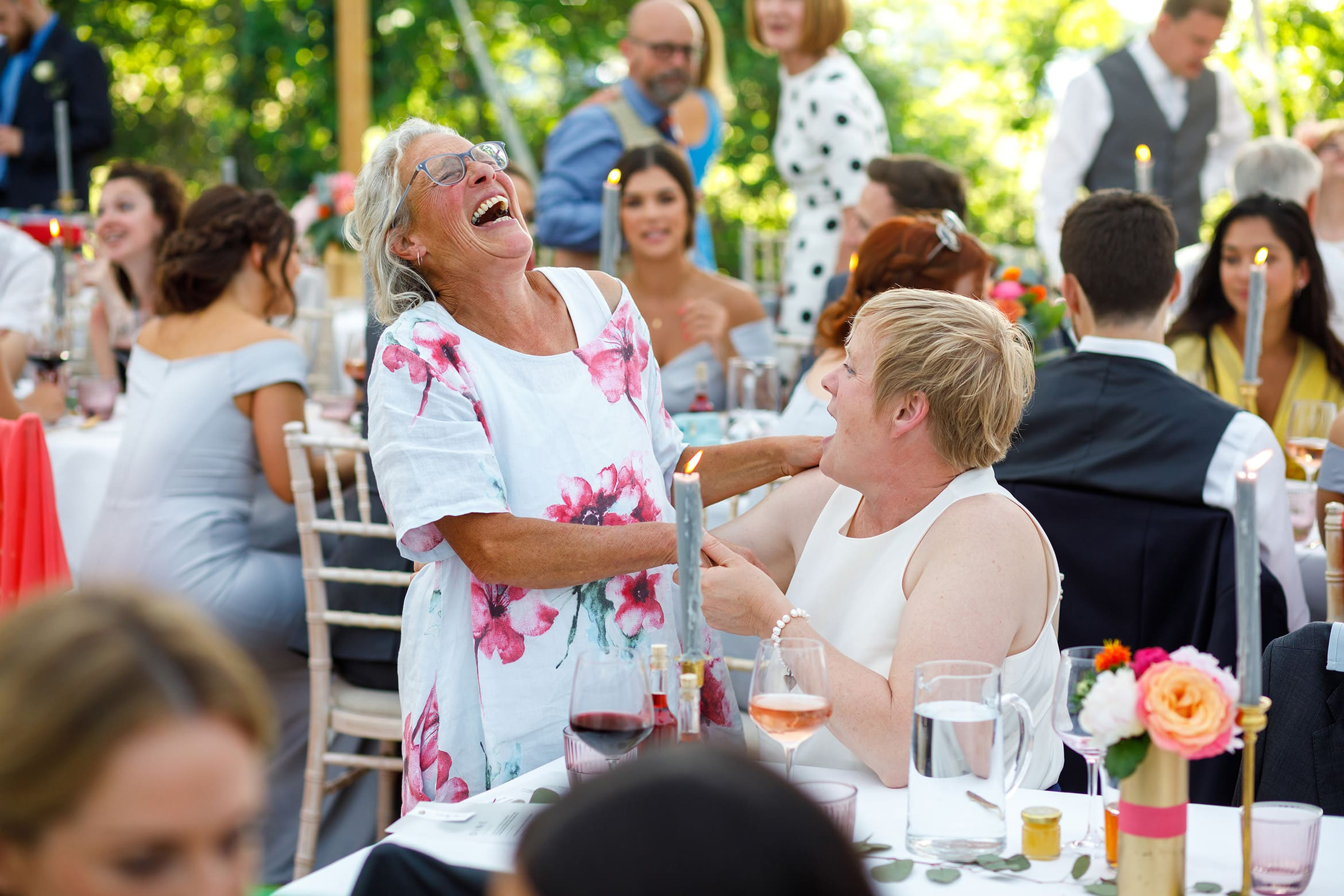 tow wedding guests share a joke