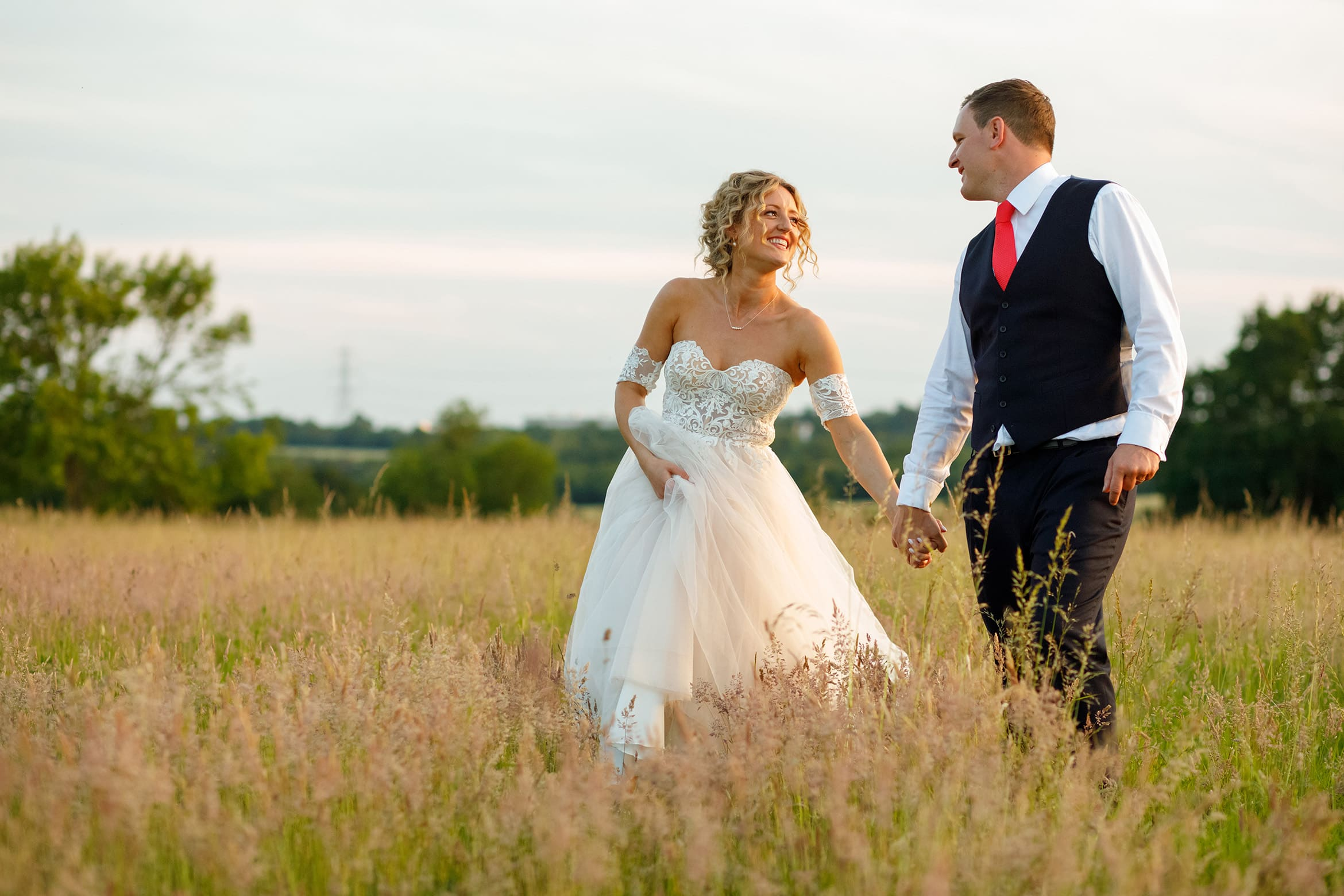 wedding portraits in a field