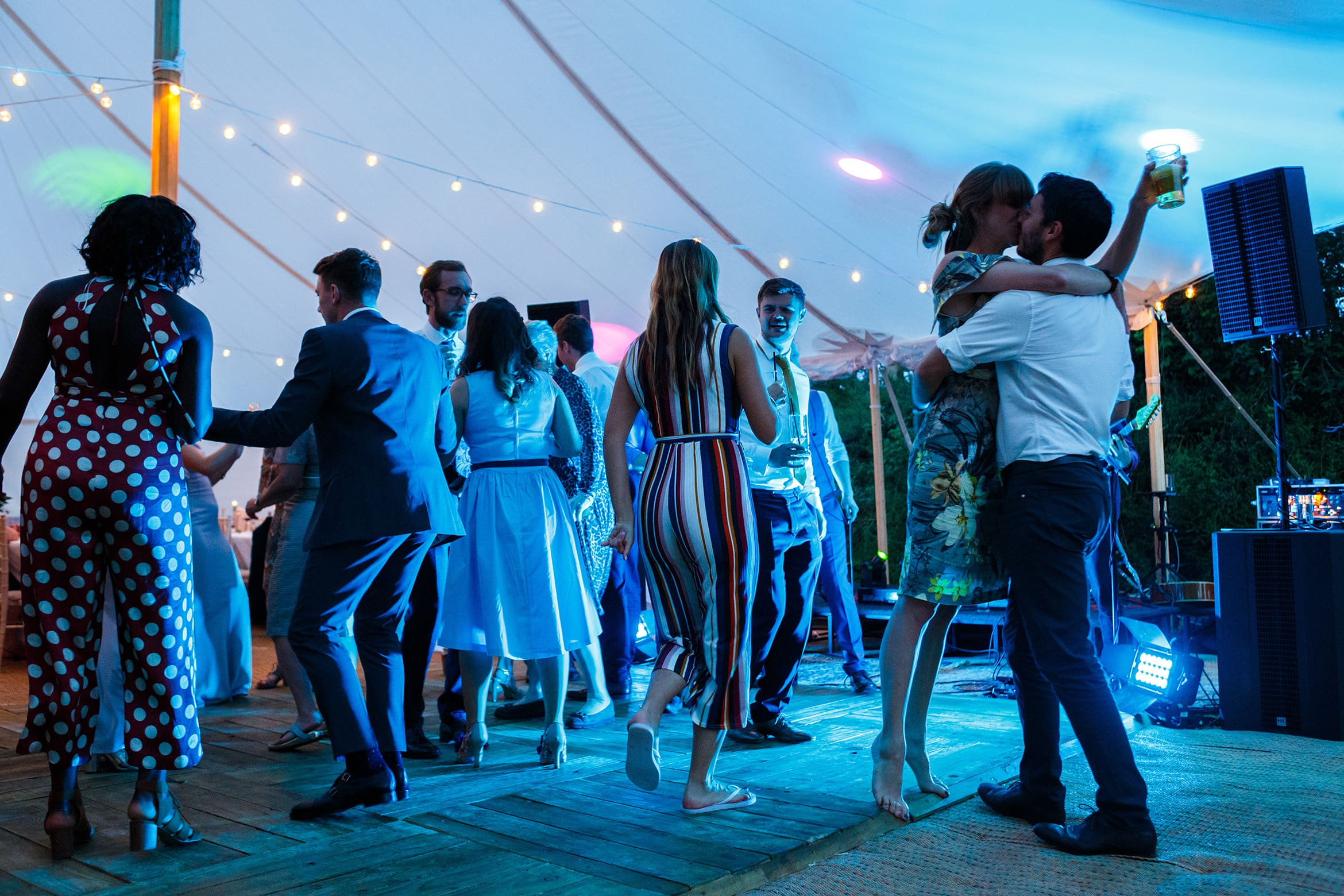 a couple kiss on the dancefloor
