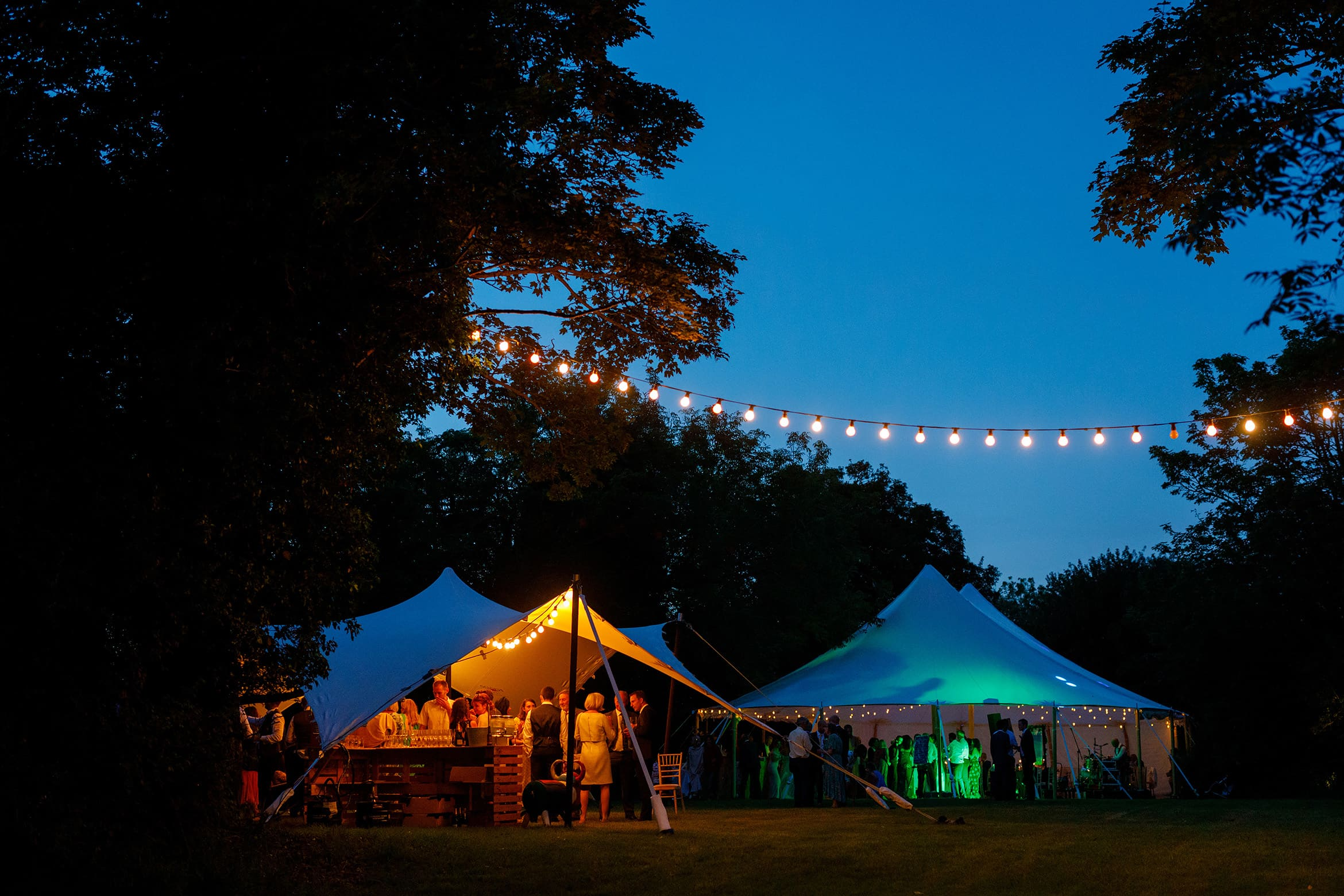 the wedding marquee as night falls