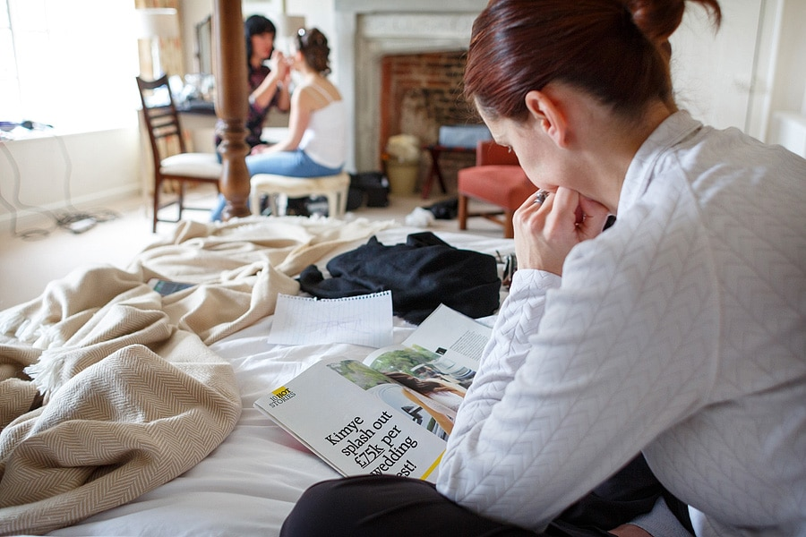 a bridesmaid reads an article in a wedding magazine