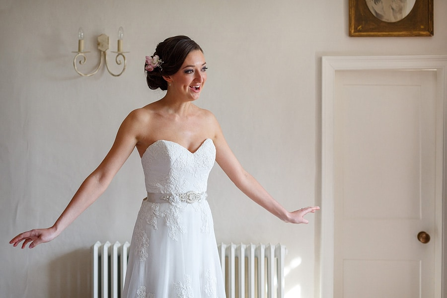 the bride with her dress on for the first time