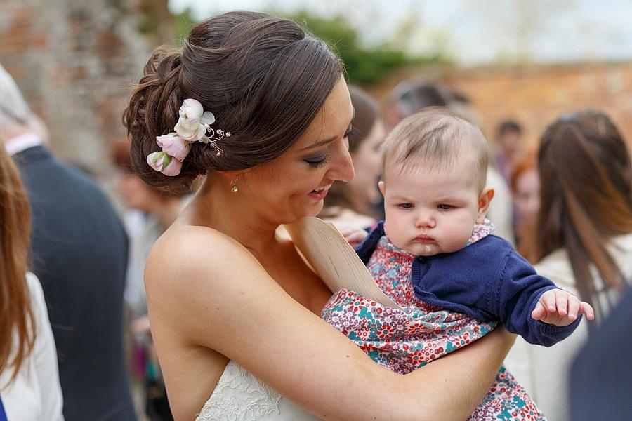 the bride and a grumpy baby