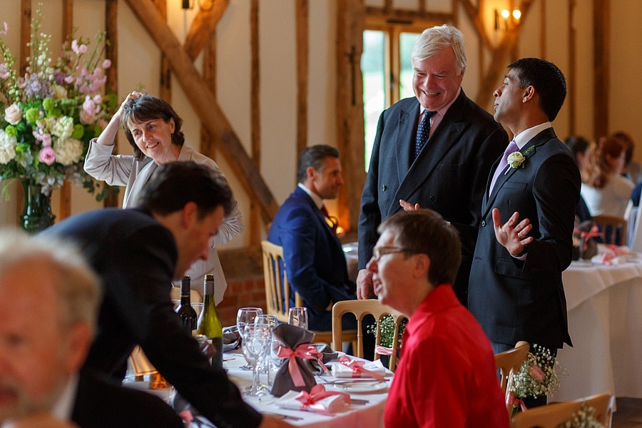 guests chat before the wedding breakfast