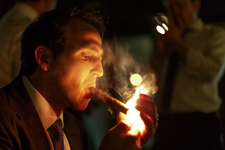 a guest lights a cigar