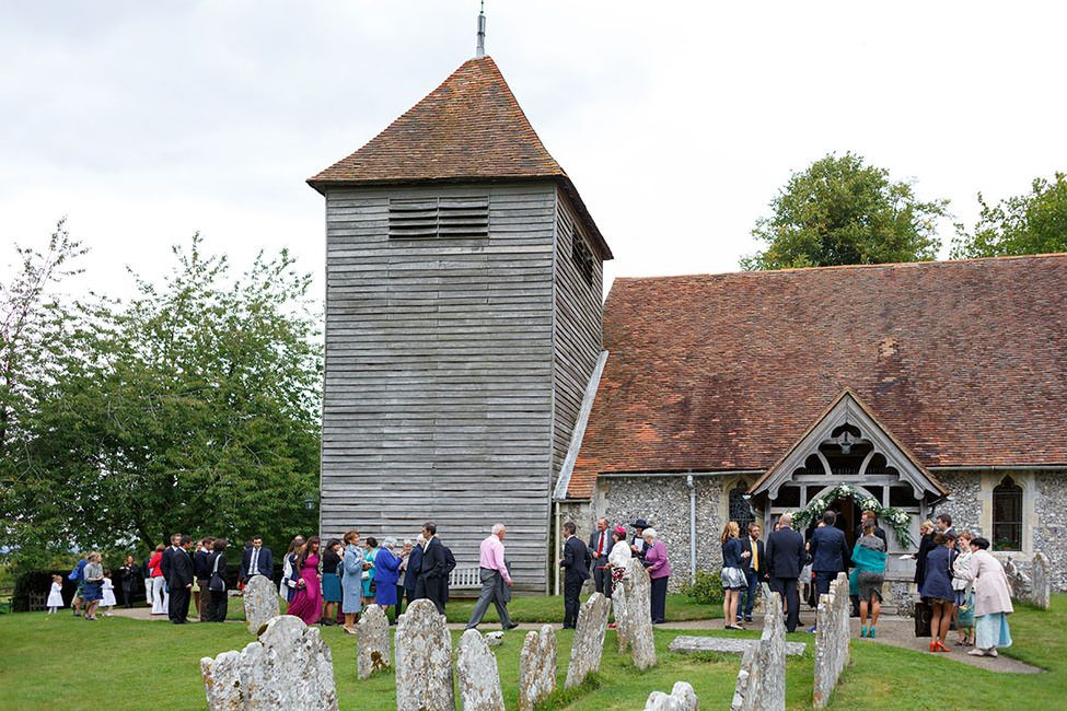 wedding guests waiting outside the church