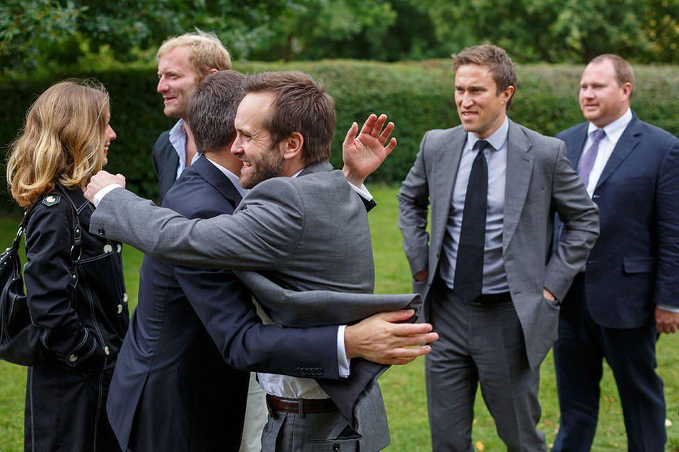groom hugging his friends