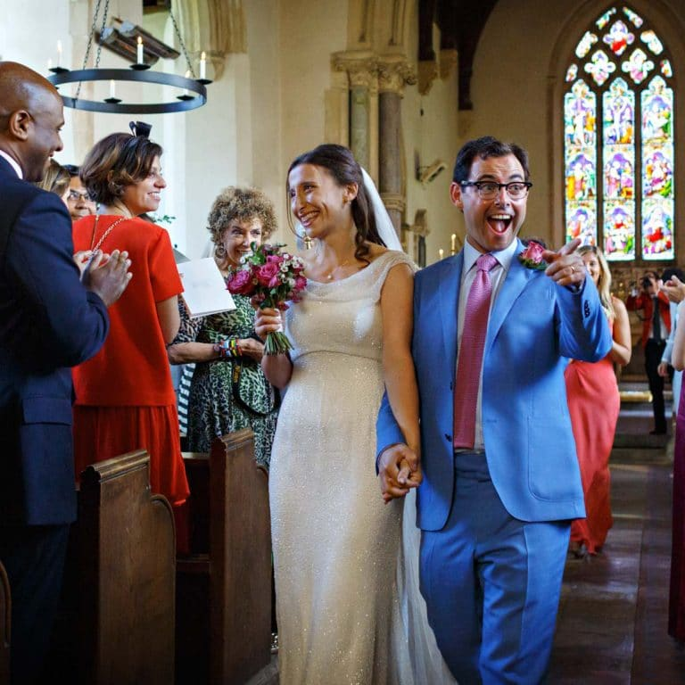 bride and groom leave gunthorpe church after their marriage