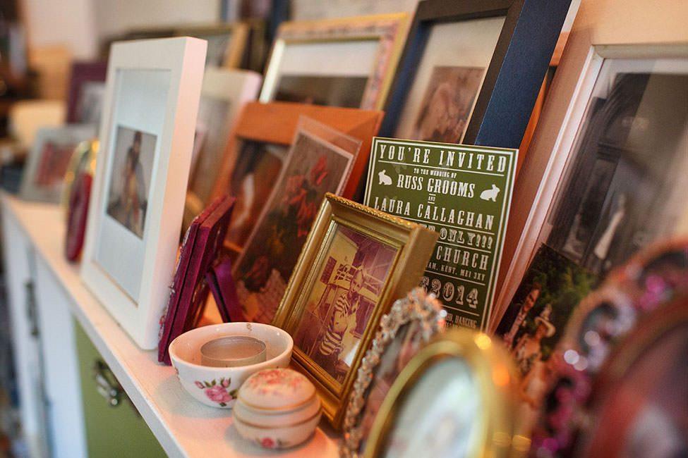 wedding invitation amongst picture frames