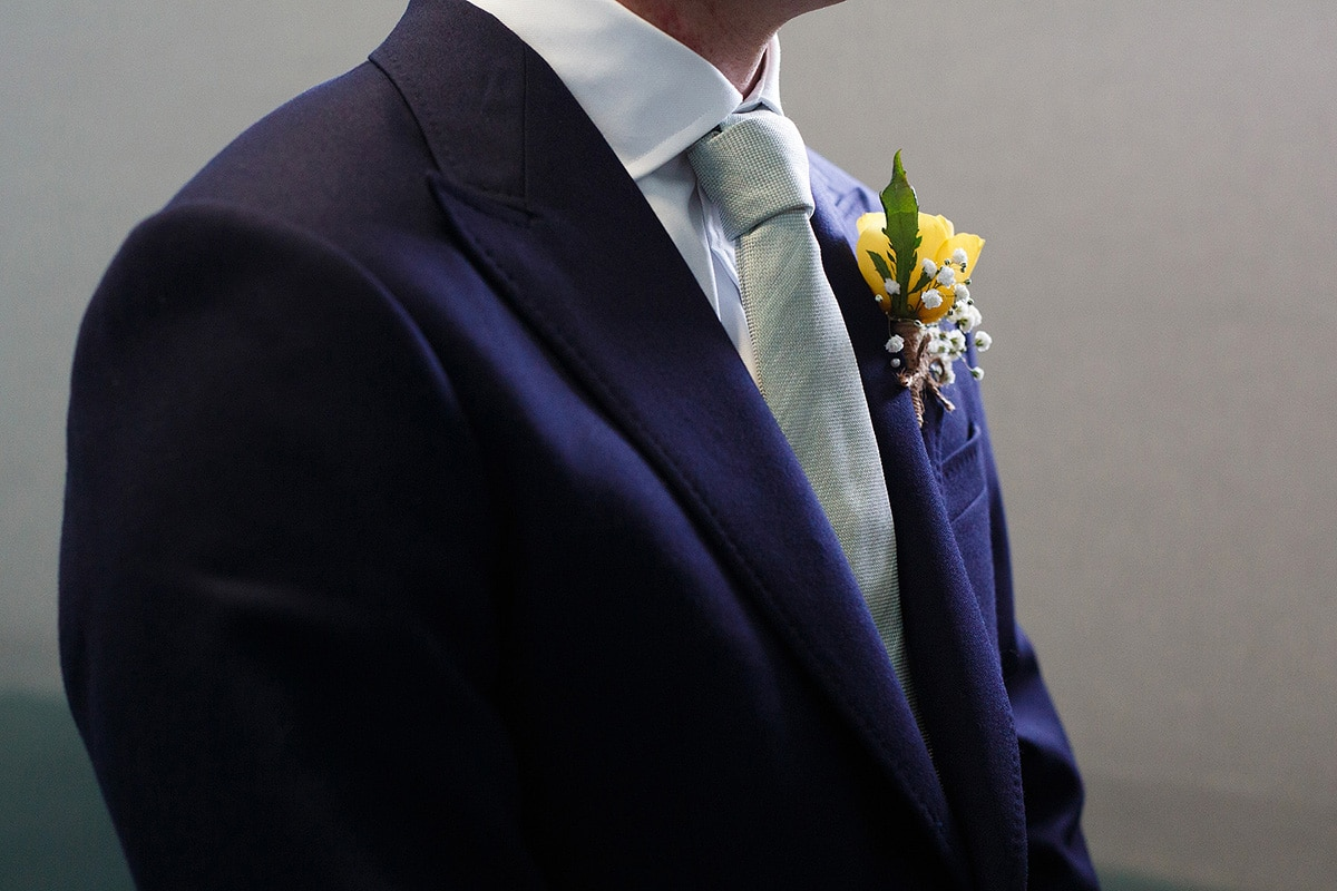 details of the grooms buttonhole
