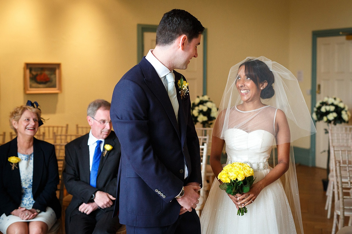 bride and groom greet each other at the beginning of the ceremony