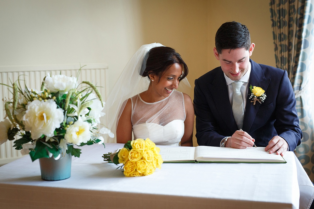 signing the register at norwich registry office