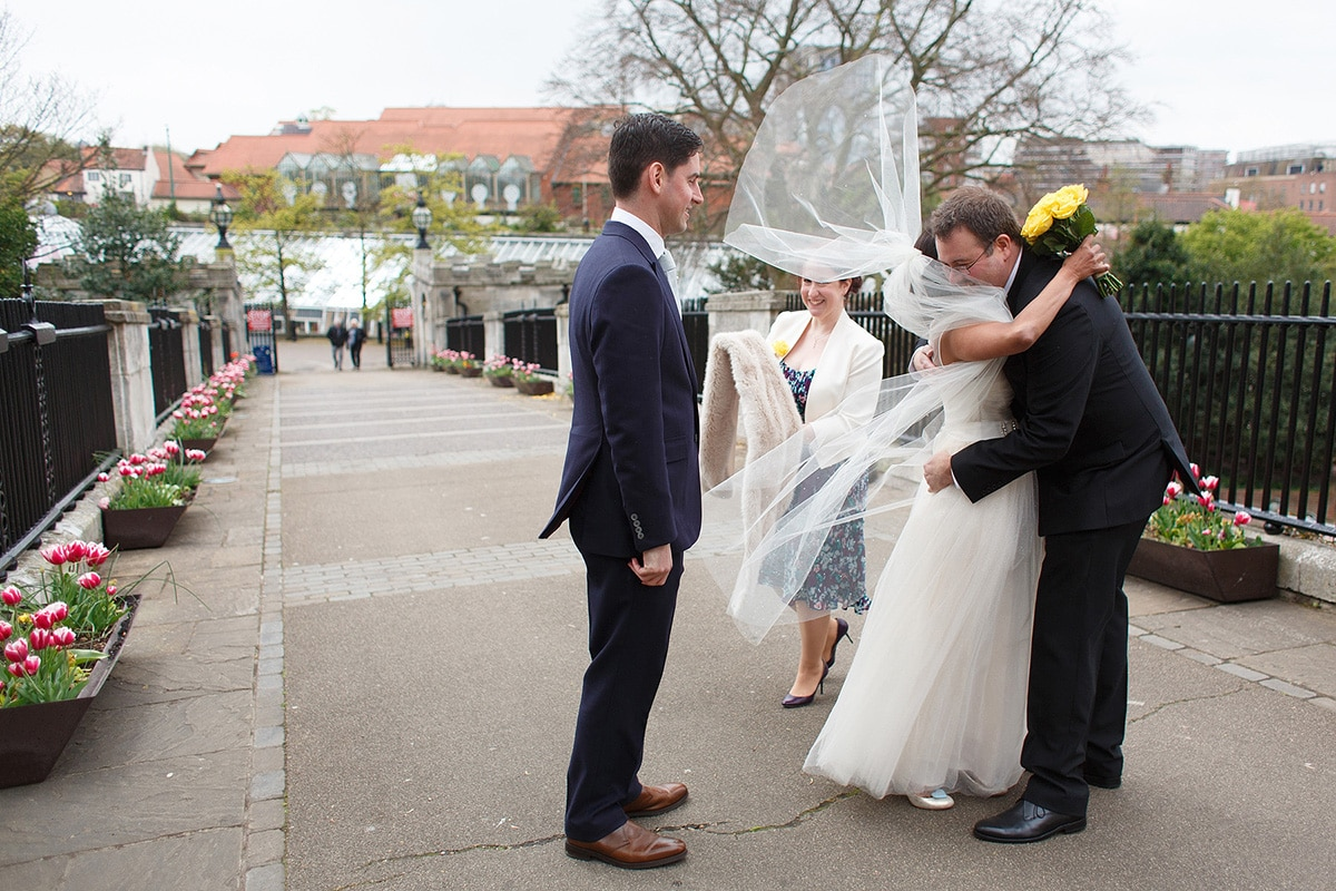 bride with veil blowing in the wind after their norwich registry office wedding