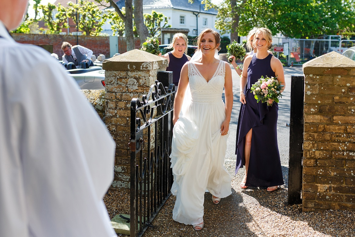 sophie and the bridesmaids outside aldeburgh church