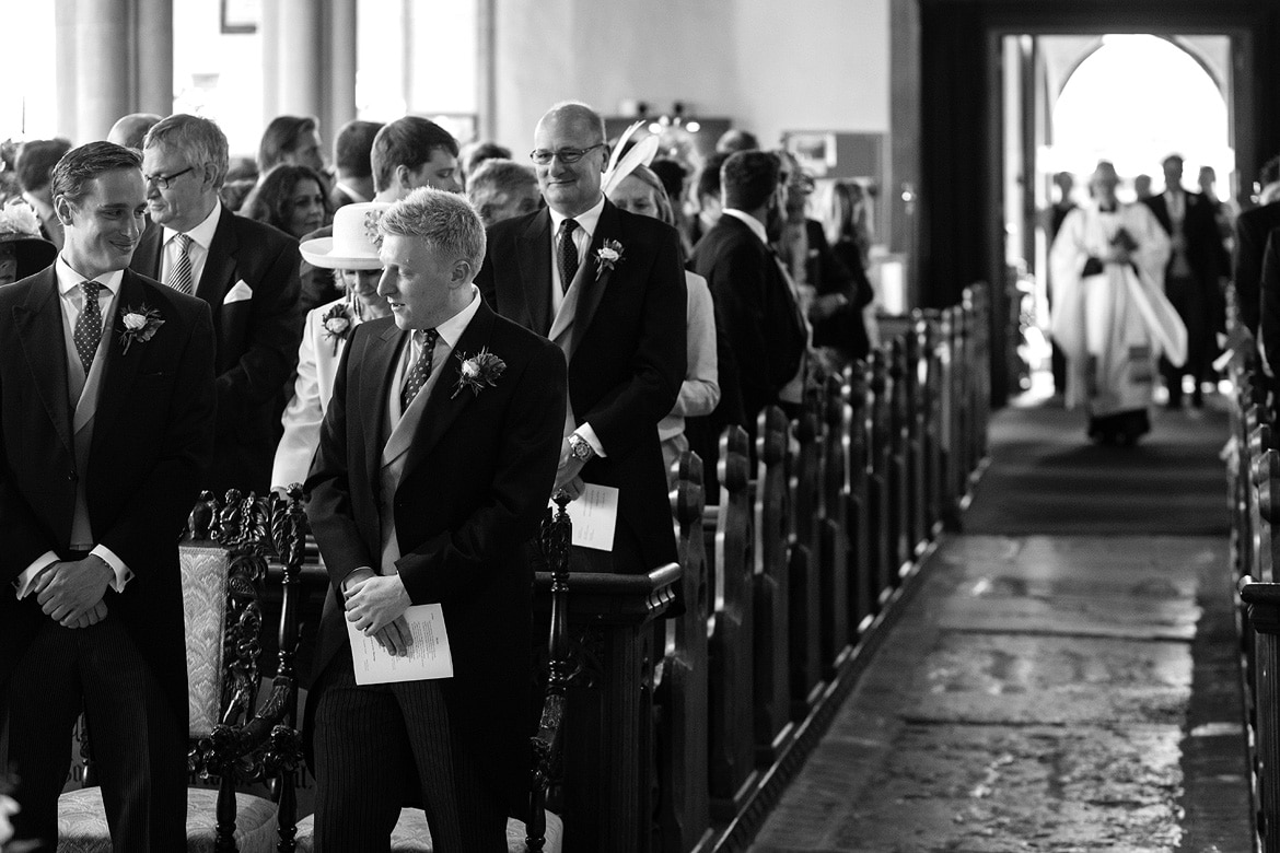 the groom waits in aldeburgh church with his best men