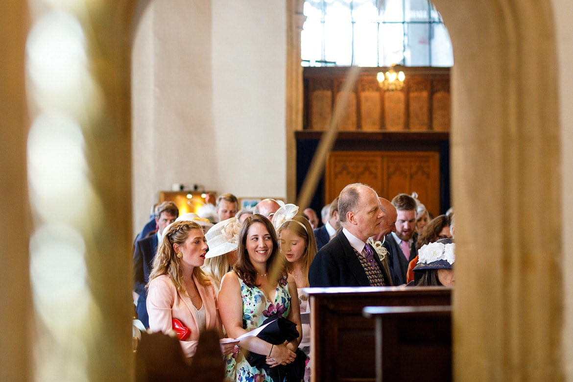 weddding guests inside aldeburgh church