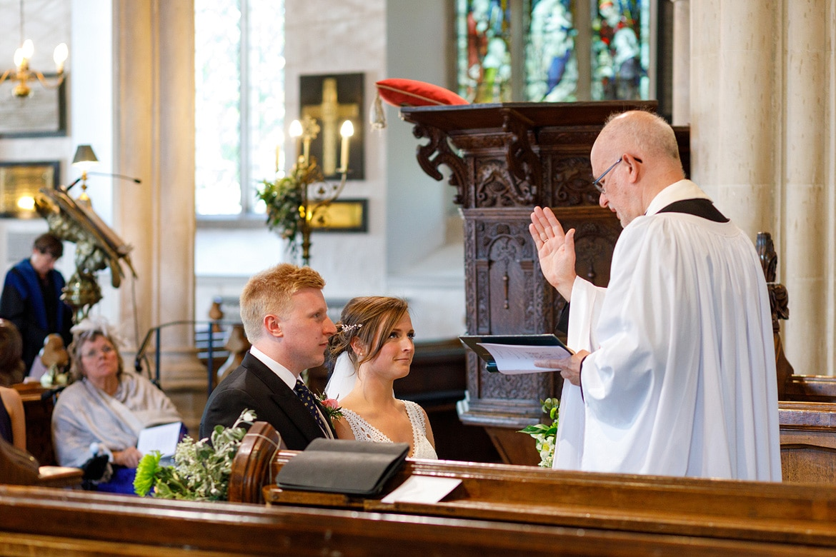 the vicar blesses the couple