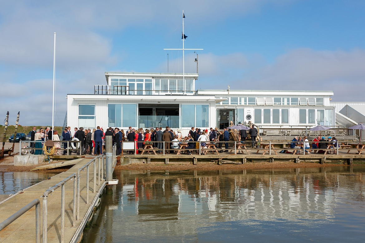 an aldeburgh yacht club wedding seen from the jetty