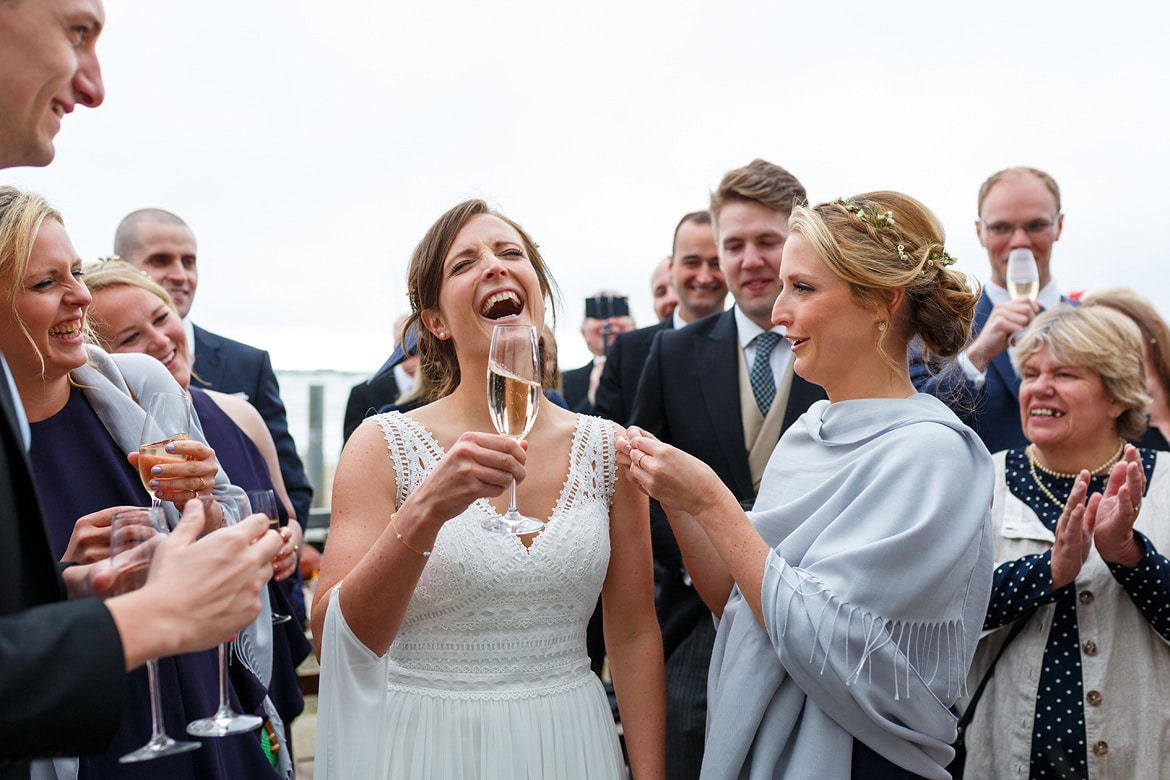the brides sister pins a badge on her