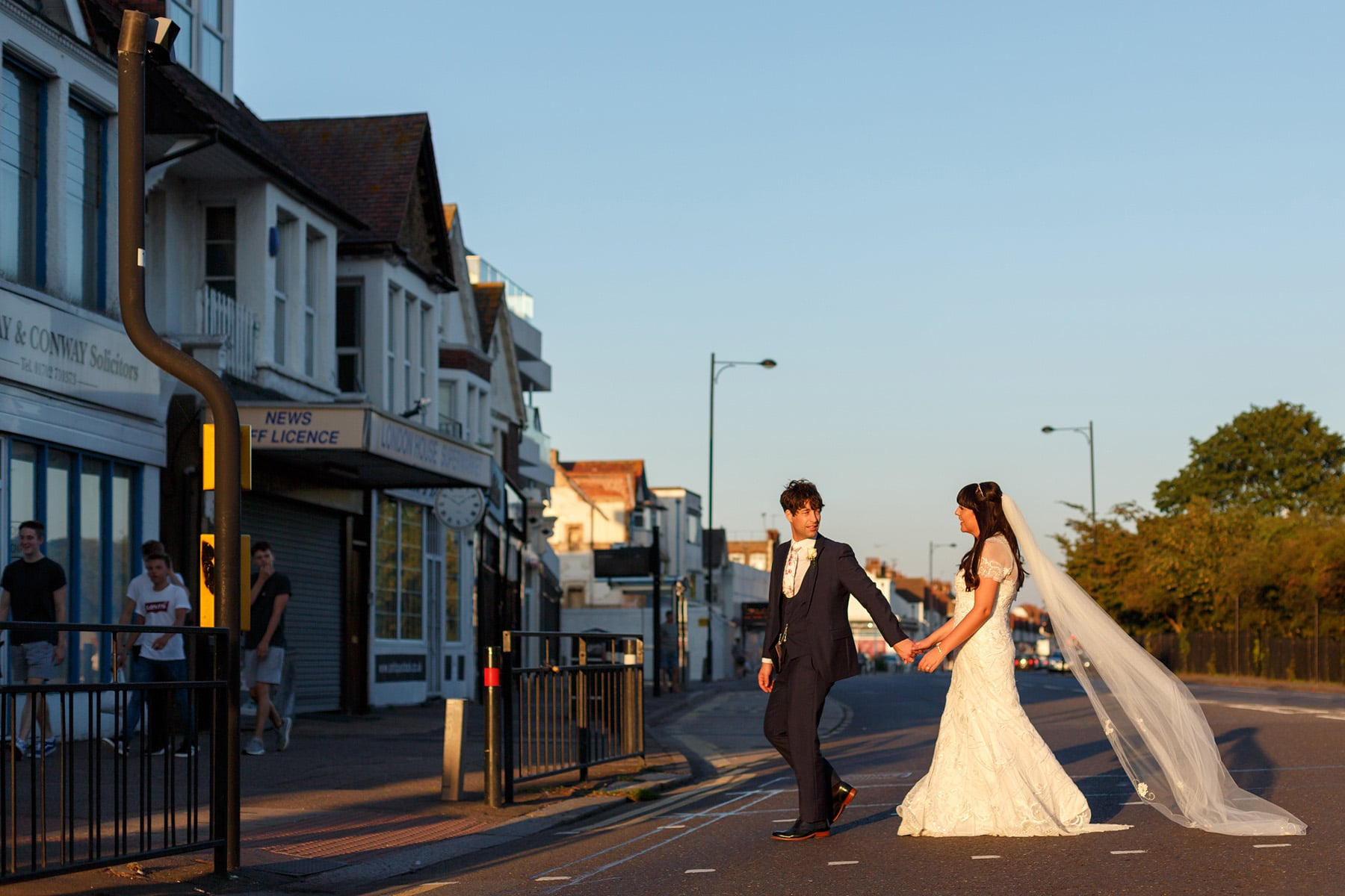 bride and groom cross the road to their arlington ballroom wedding