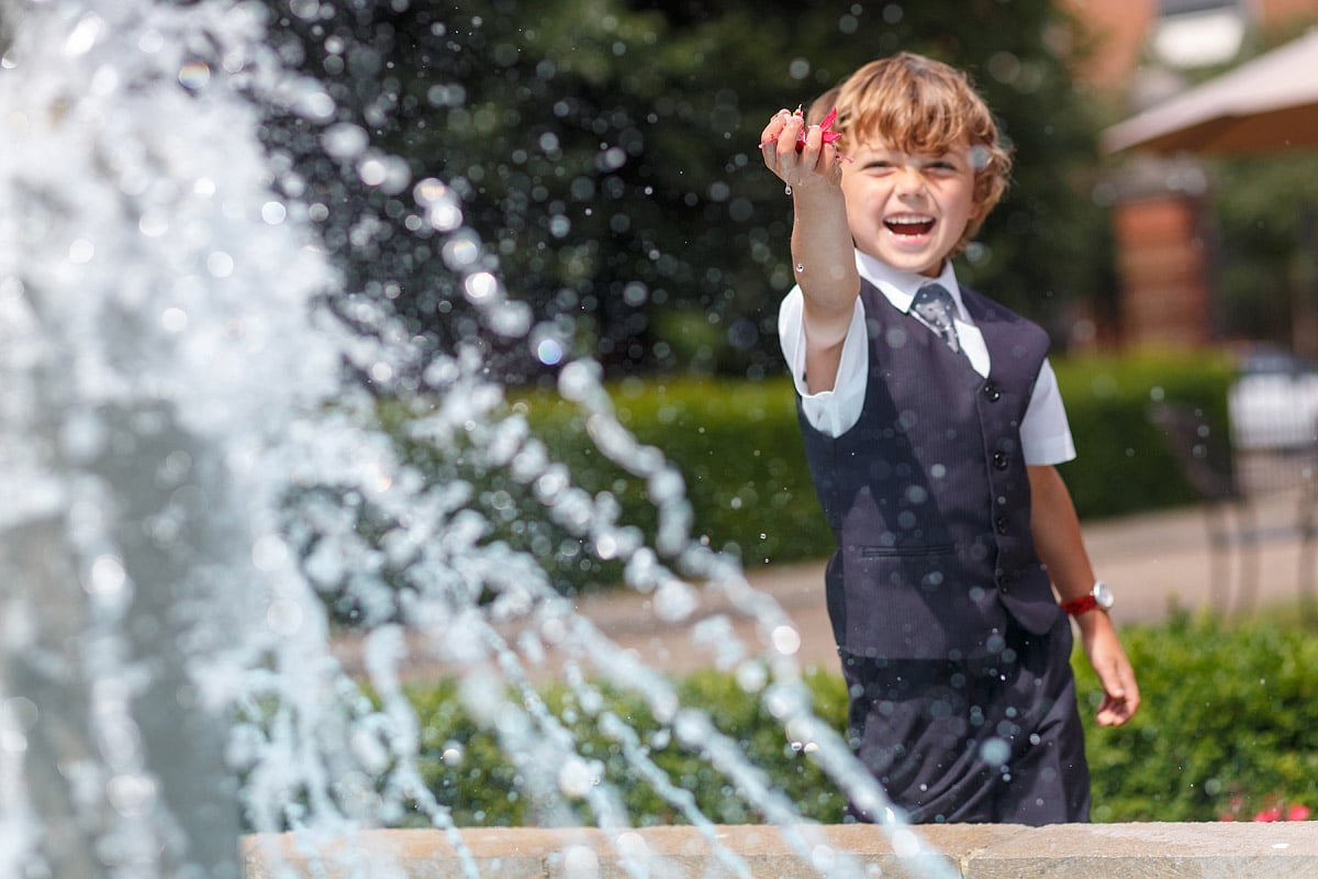 a page boy playing in the fountain