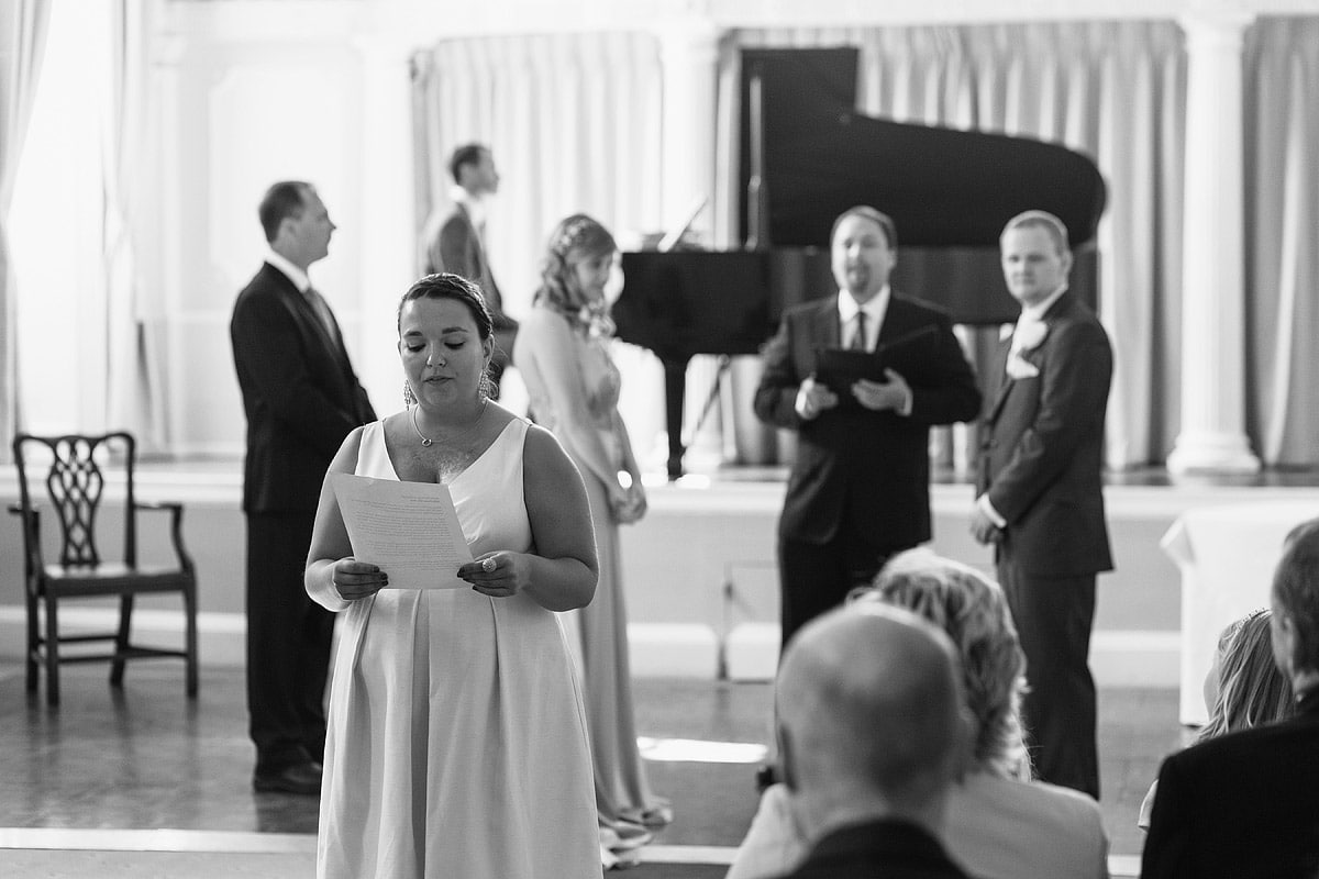a bridesmaid speaks during the service