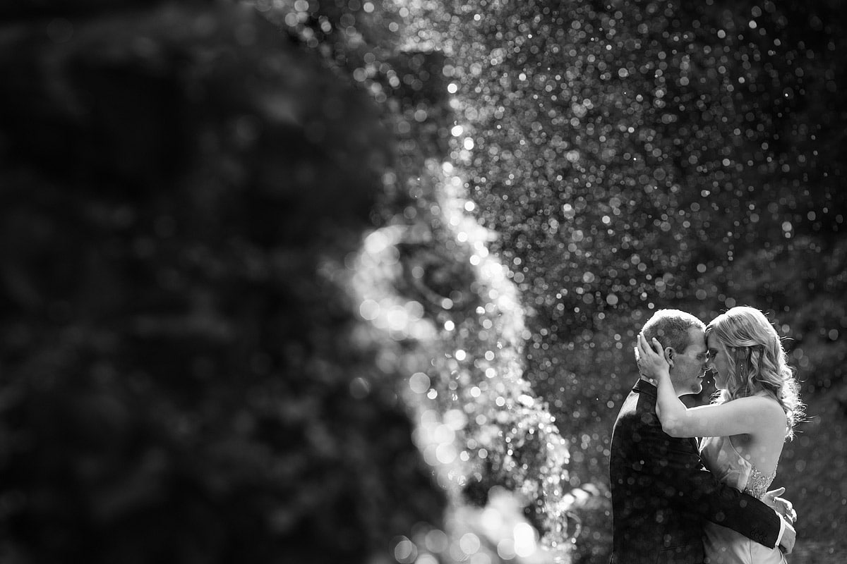 wedding portrait through the plantation gardens fountain in norwich