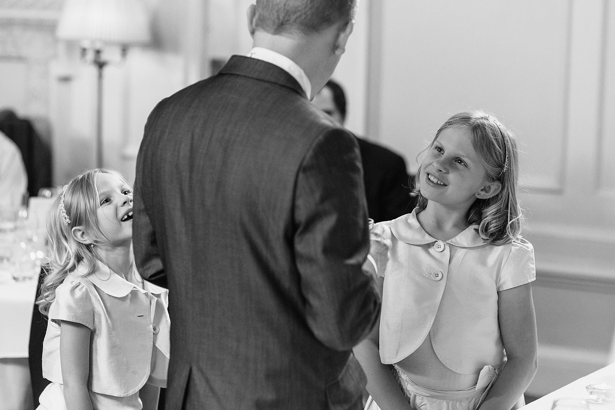 a flowergirl talks to the groom