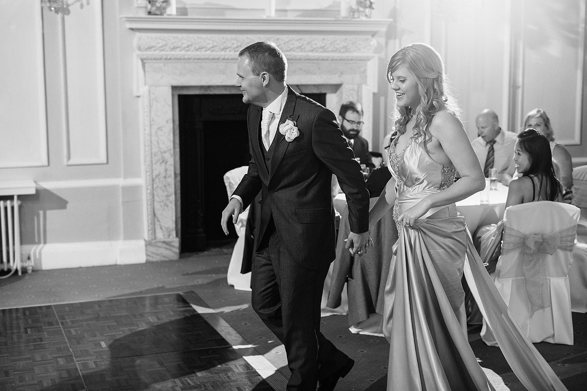 bride and groom enter the dancefloor