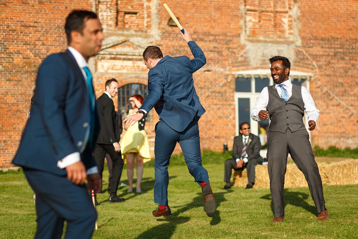 wedding guests playing rounders at a godwick barn wedding