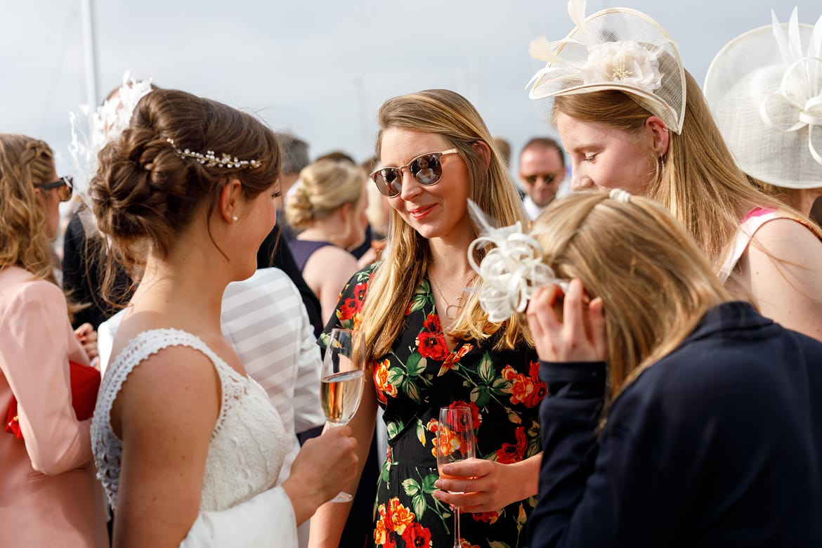 the bride reflected in a guests glasses at aldeburgh yacht club