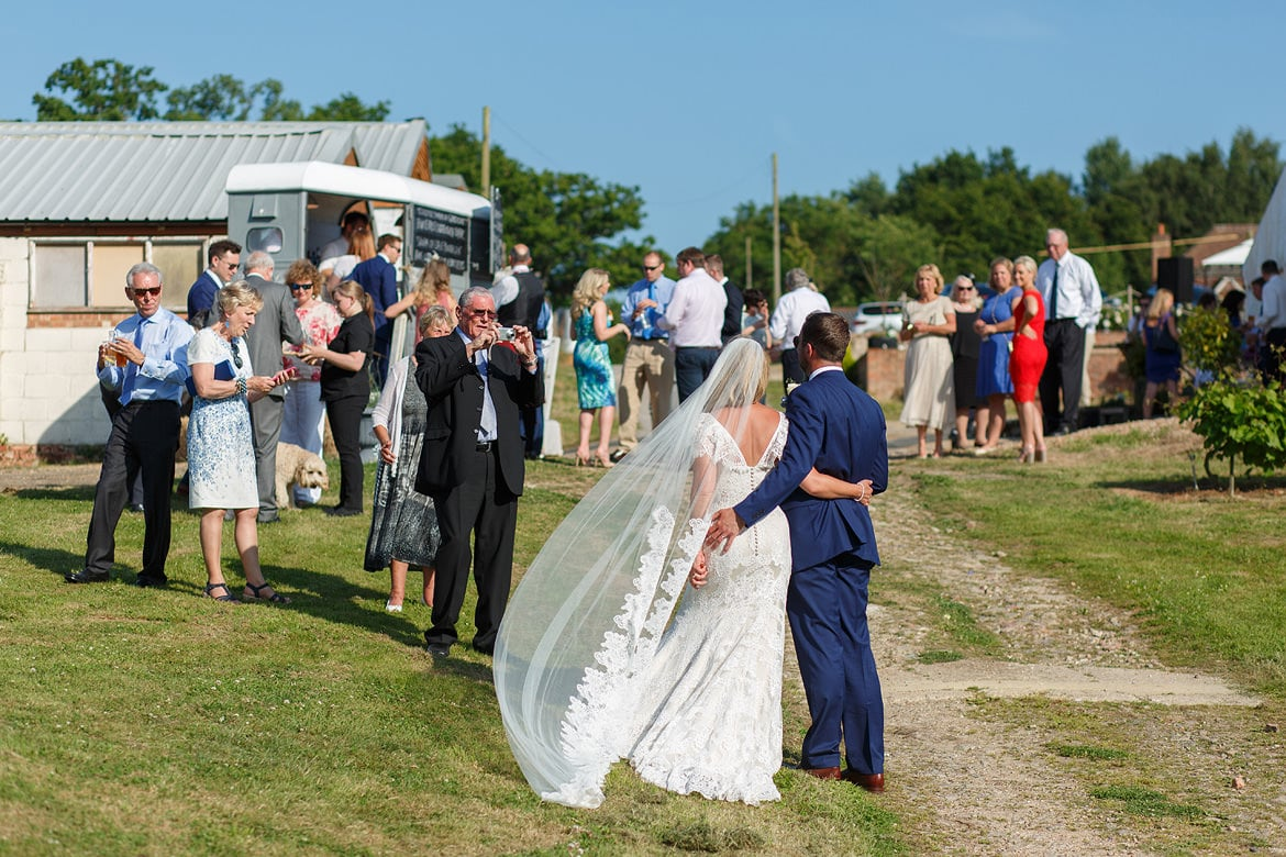 wedding guests take photos at a bluebell vineyard wedding
