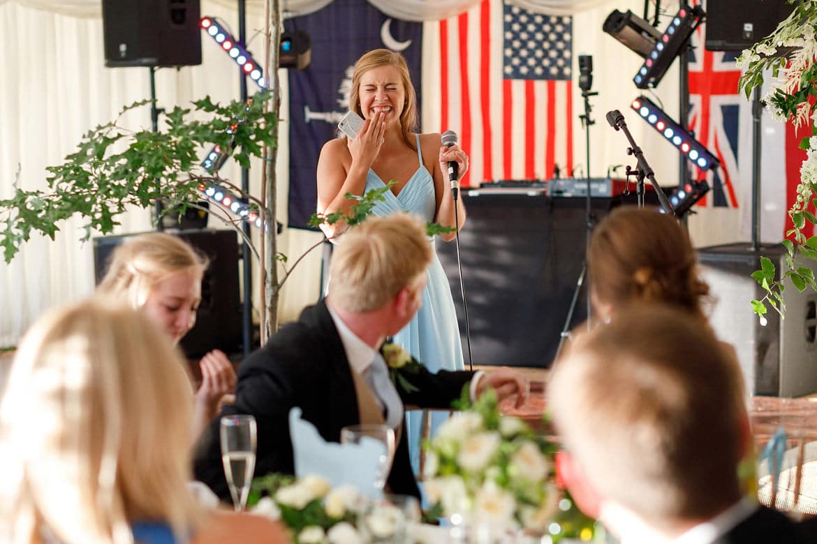 the brides sister laughs during her speech