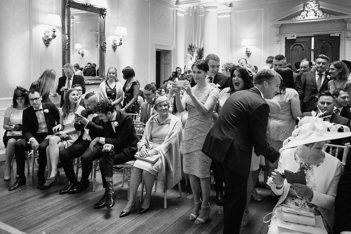 guests take photos at a hedsor house wedding