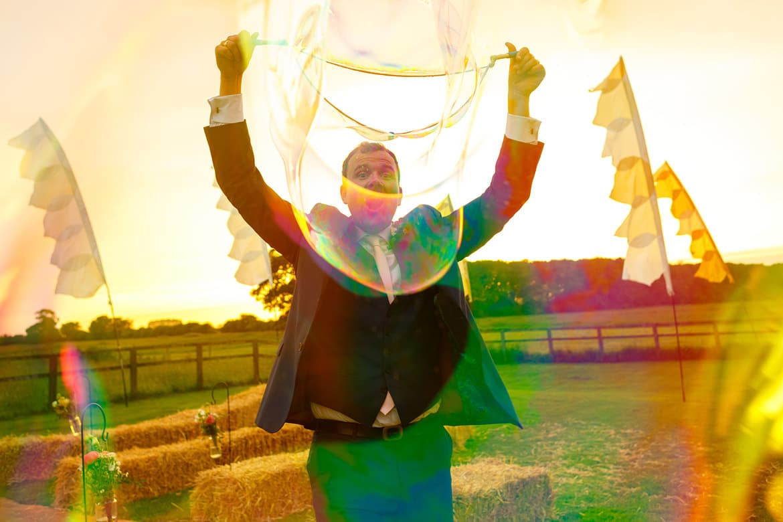 blowing bubbles ata godwick barn wedding