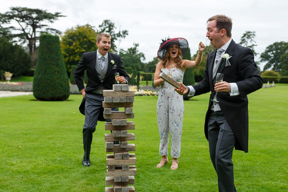 wedding guests playing jenga at a hengrave hall wedding